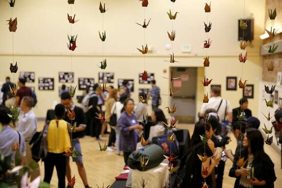 Paper cranes hang in columns at a show highlighting the experiences of undocumented pan-Asian youth at The Women's Building in San Francisco, California, on Wednesday, Aug. 26, 2015.