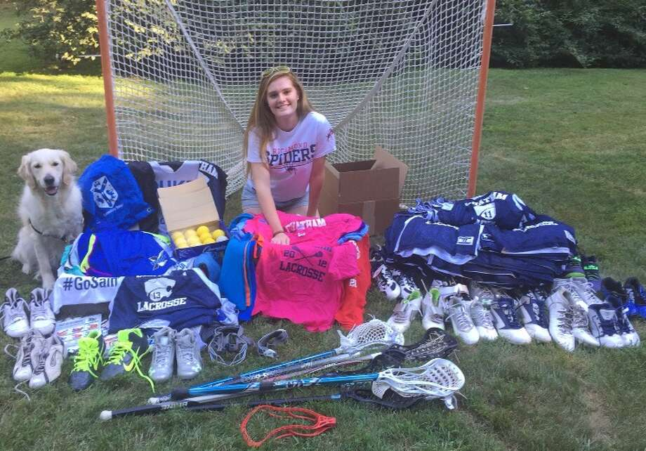 Madeline Finnen, a senior lacrosse player at the Canterbury School in New Milford, poses with a mountain of equipment, which she brought to Jamaica on her trip with the Fields of Growth program. Photo: Contributed / Contributed / News-Times Contributed