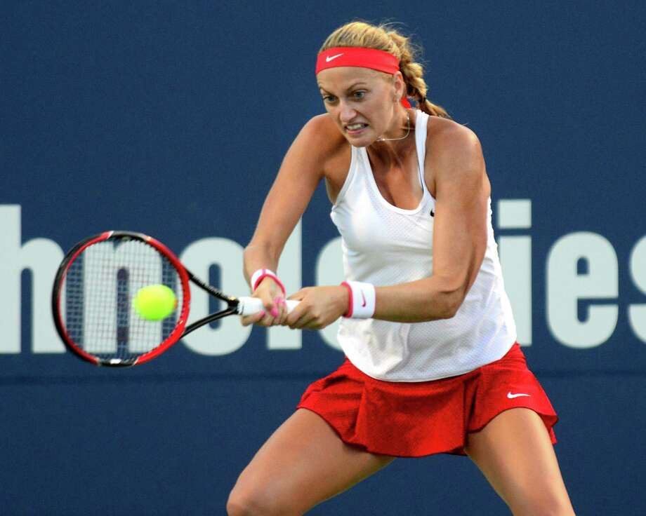 Defending champion Petra Kvitova returns the ball as she plays against Agnieszka Radwanska, during Connecticut Open tennis action in New Haven, Conn. on Thursday August 27, 2015. Photo: Christian Abraham / Hearst Connecticut Media / Connecticut Post
