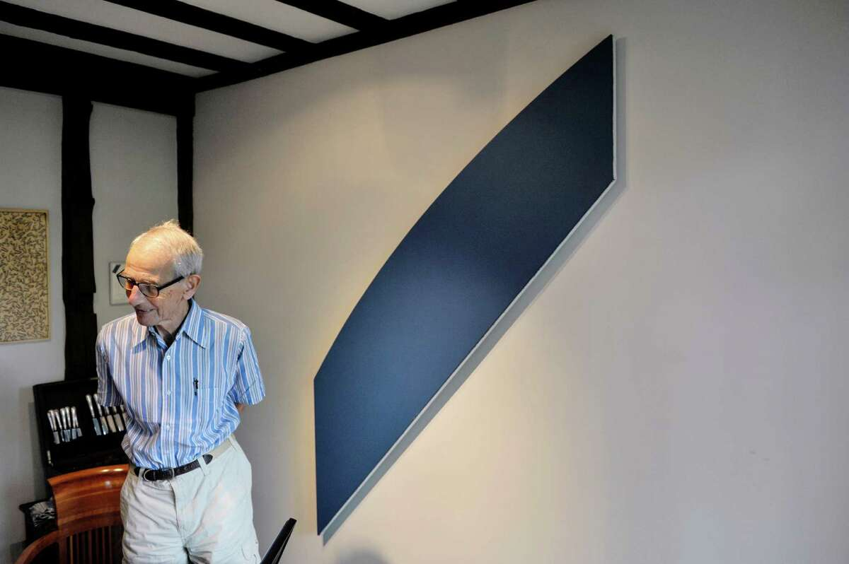 Werner Feibes, a retired architect, at his home on Tuesday, Aug. 25, 2015, in Schenectady, N.Y. On the wall is a piece of artwork by Ellsworth Kelly, entitled Diagonal with Curve XII. (Paul Buckowski / Times Union)