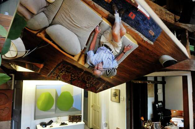 Werner Feibes, a retired architect, at his home on Tuesday, Aug. 25, 2015, in Schenectady, N.Y.  Feibes is reflected in an artwork by artist George Rickey entitled One Plane Hanging Oblique.  (Paul Buckowski / Times Union) Photo: PAUL BUCKOWSKI / 00033113A