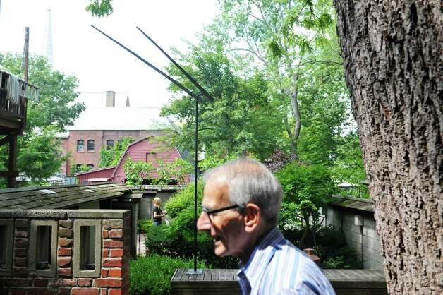 Werner Feibes, foreground, a retired architect, at his home on Tuesday, Aug. 25, 2015, in Schenectady, N.Y.  In the background is a piece of artwork by artist George Rickey entitled Two Lines.  (Paul Buckowski / Times Union) Photo: PAUL BUCKOWSKI / 00033113A