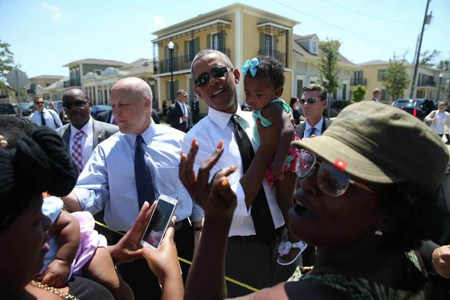 President Barack Obama and New Orleans Mayor Mitch Landrieu, left, tour the Yvonne Marrero Commons, built on the site of a dilapidated former housing complex. Photo: DOUG MILLS, STF / NYTNS