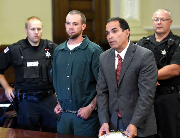 Daniel P. Reuter, left, stands with his attorney Jay Hernandez while his is arraigned on murder charges Monday morning Sept. 8, 2014, at Rensselaer County Court in Troy, N.Y.   (Skip Dickstein/Times Union) Photo: SKIP DICKSTEIN / 00028502A
