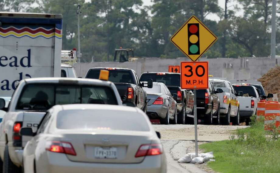 Traffic lines up along Riley Fuzzel near the insection of Rayford where the Grand Parkway is under construction shown Thursday, Aug. 27, 2015, in Spring.   ( Melissa Phillip  / Houston Chronicle ) Photo: Melissa Phillip, Staff / © 2015 Houston Chronicle