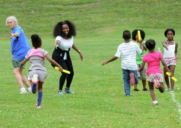 Adults and children take part in a team relay race as part of the End-of-Summer City of Albany Department of Recreation's Allympics Event at Lincoln Park on Thursday Aug. 27, 2015 in Greenwich, N.Y. (Michael P. Farrell/Times Union) Photo: Michael P. Farrell / 00033105A