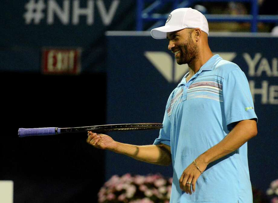 James Blake spins his racquet on his finger as he plays a match against Andy Roddick in the Men's Legend Series at the Connecticut Open tennis tournament in New Haven, Conn. on Thursday August 27, 2015. Photo: Christian Abraham / Hearst Connecticut Media / Connecticut Post