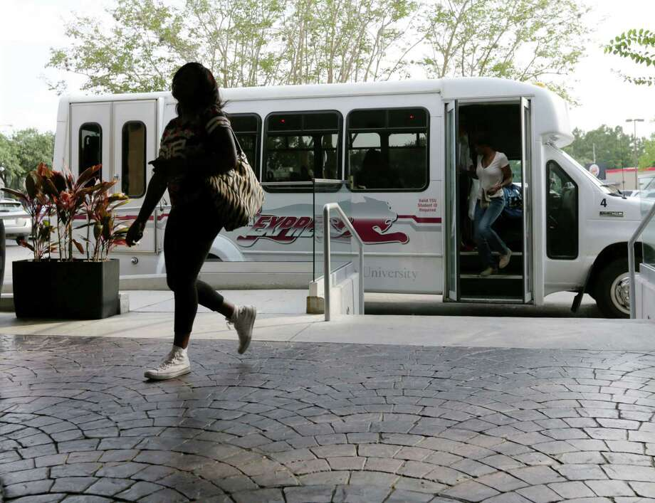 April Porter, an 18-year old TSU freshman, arrives at the Wyndam. Some students like the hotel for now but find a shuttle to campus inconvenient. Photo: Jon Shapley, Staff / © 2015 Houston Chronicle