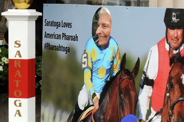 Rhoda Marks of Florida poses behind an American Pharoah cut out on Broadway on Wednesday Aug. 26, 2015 in Saratoga Springs, N.Y.  (Michael P. Farrell/Times Union) Photo: Michael P. Farrell / 00033149A