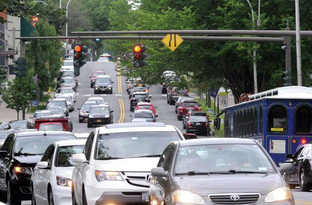 A car filled section of Broadway on Wednesday Aug. 26, 2015 in Saratoga Springs, N.Y.  (Michael P. Farrell/Times Union) Photo: Michael P. Farrell / 00033149A