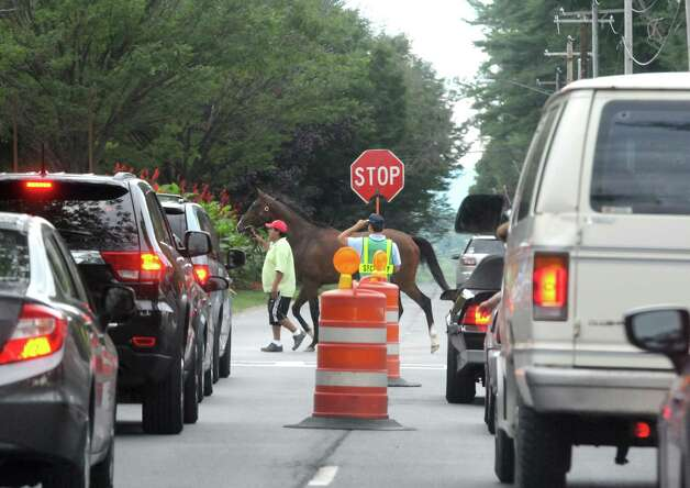 A horse crossing Union Avenue on Wednesday Aug. 26, 2015 in Saratoga Springs, N.Y.  (Michael P. Farrell/Times Union) Photo: Michael P. Farrell / 00033149A