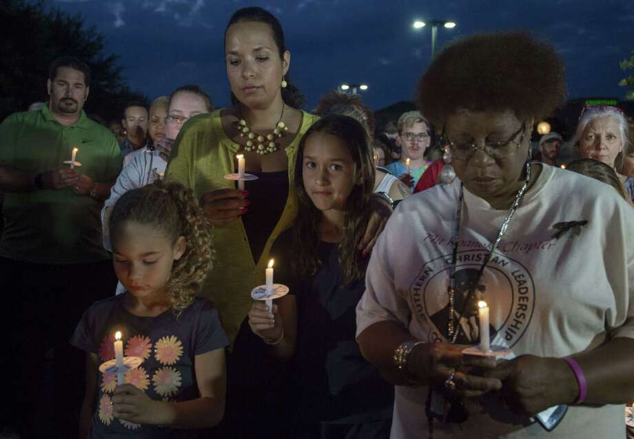 "People participate in a candlelight vigil on the front driveway of WDBJ-TV's television studios  on August 27, 2015,  in Roanoke, Virginia. The former television reporter who shot dead two journalists during a live US broadcast before killing himself warned he had been a ""human powder keg... just waiting to go BOOM."" The gunman -- Vester Lee Flanagan, 41, also known as Bryce Williams --posted chilling footage of Wednesday's shocking double murder online. Reporter Alison Parker, 24, and cameraman Adam Ward, 27, were shot and killed at close range while conducting an on-air interview at the shopping center for WDBJ, a CBS affiliate in Roanoke, Virginia, about 240 miles (385 kilometers) southwest of Washington. Friends, family and the community at large mourned the tragedy, which renewed calls for tougher gun laws in the United States. Flanagan was said to have bought his gun legally.    AFP PHOTO/PAUL J. RICHARDSPAUL J. RICHARDS/AFP/Getty Images Photo: PAUL J. RICHARDS, Staff / AFP / Getty Images / AFP"
