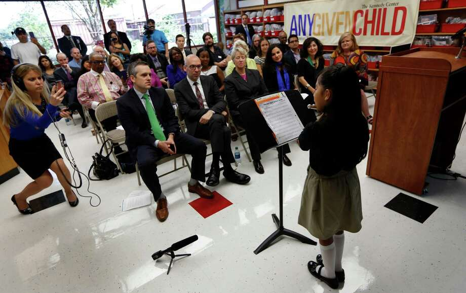 Whittier Elementary School 4th grader Marifer Lopez plays her flute solo Thursday, Aug. 27, 2015, in Houston. Lopez performed during a press conference announcing partnership between Washington's Kennedy Center, HISD and City of Houston in national arts education program. Houston is 19th city selected to join the program. Photo: Steve Gonzales, Houston Chronicle / © 2015 Houston Chronicle