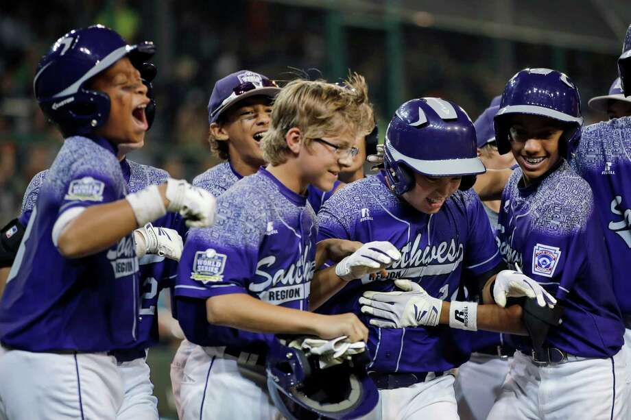 Pearland's Zack Mack, second from right, celebrates with teammates after he hit a grand slam during the first inning of a U.S. elimination game at the Little League World Series. Photo: Matt Slocum, STF / AP