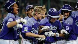 Pearland's Zack Mack, second from right, celebrates with teammates after he hit a grand slam during the first inning of a U.S. elimination game at the Little League World Series.