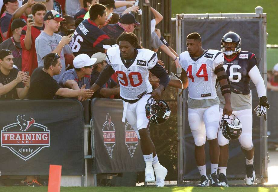 The Texans are taking things slow with outside linebacker Jadeveon Clowney (90), who's completing his second week of practice since returning from knee surgery last season. Photo: Brett Coomer, Staff / © 2015 Houston Chronicle