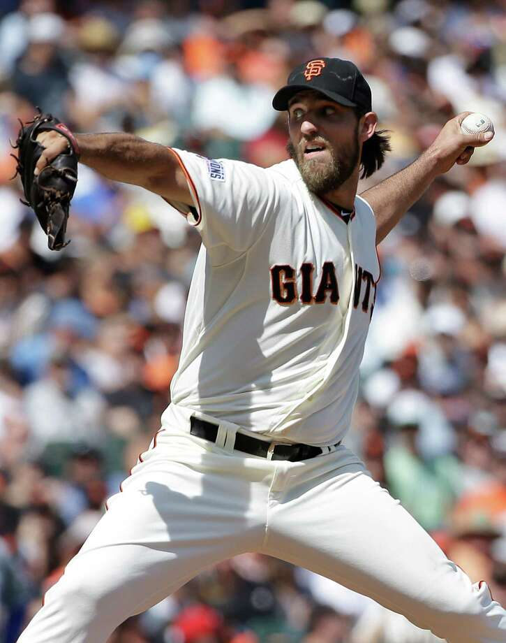 San Francisco Giants pitcher Madison Bumgarner throws against the Chicago Cubs during the sixth inning of a baseball game in San Francisco, Thursday, Aug. 27, 2015. (AP Photo/Jeff Chiu) ORG XMIT: FXPB109 Photo: Jeff Chiu / AP