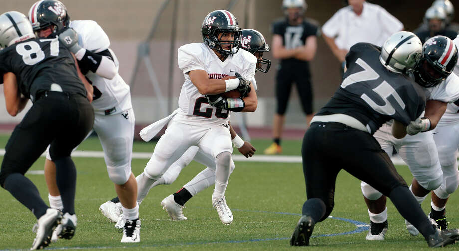 """Charger running back Jordan Cardenas picks a way through the middle as Clark hosts Churchill in the """"Gucci Bowl"""" at Farris Stadium  on August 27, 2015. Photo: Tom Reel / San Antonio Express-News"""