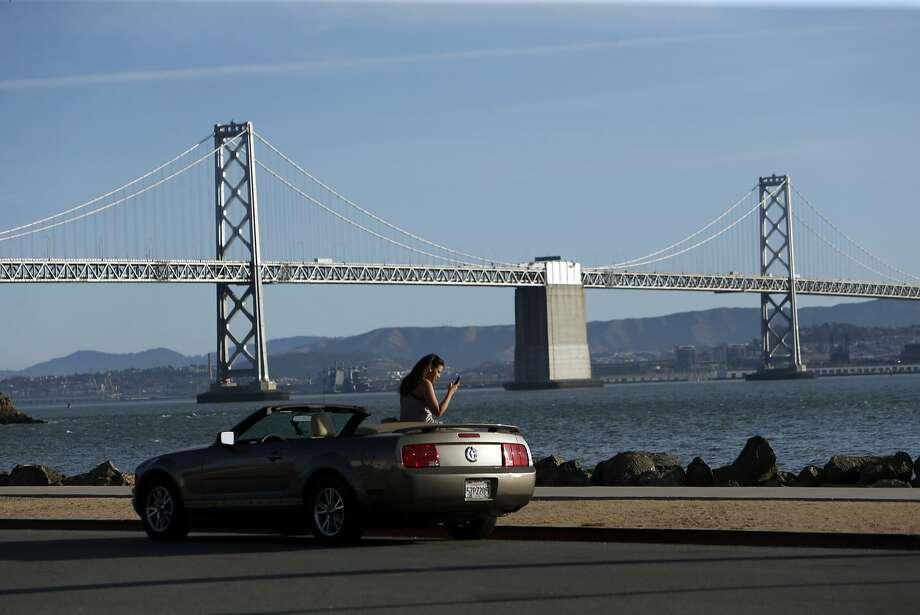 German tourist Sarah Hernandez takes a photo on Treasure Island in San Francisco, Calif., on Thursday, Aug. 27, 2015. Photo: Scott Strazzante, The Chronicle