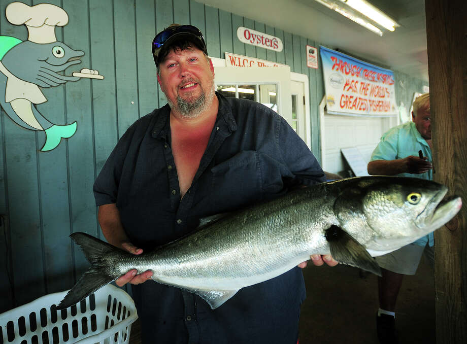 David Glatzel, of New Milford, shows off the 13.72 pound bluefish he weighed in as part of The Greatest Bluefish Tournament on Earth at Captain's Cove Marina in Bridgeport, Conn. on Sunday, August 24, 2014. Photo: Brian A. Pounds / Brian A. Pounds / Connecticut Post