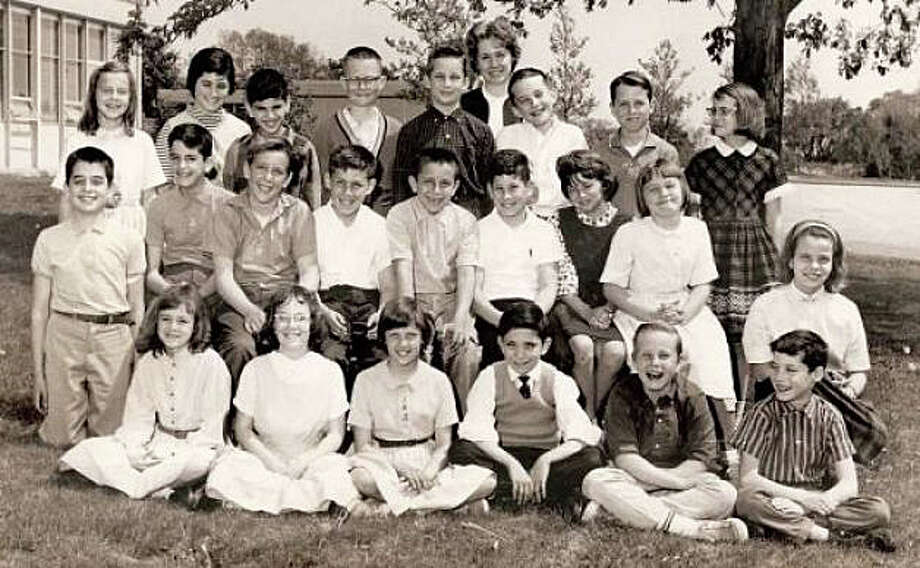 "In kindergarten at the ""long-gone"" Burr Farms Elementary School, columnist Dan Woog, recalls: ""I learned I was not as smart as I thought I was. When Mrs. Fuller asked who knew the days of the week, I blurted out without even raising my hand: 'MondayTuesdayWednesdayThursdayFridaySaturdaySunday!' I was quite proud of myself. She shot me a withering look. 'No, Danny,' she said sharply. 'The week always starts on Sunday.' The photo is a typical Burr Farms School sixth-grade class from an era of black-and-white school photos ... Mr. Woog is not among this smiling group (we think). Photo: Contributed / Contributed Photo / Westport News"
