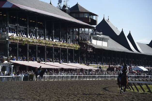 Thousands of people were inside Saratoga Race Course ahead of American Pharoah's 8:45 a.m. workout. The Triple Crown winner is in the Saratoga Springs for Saturday's running of the Travers Stakes. (Skip Dickstein / Times Union)