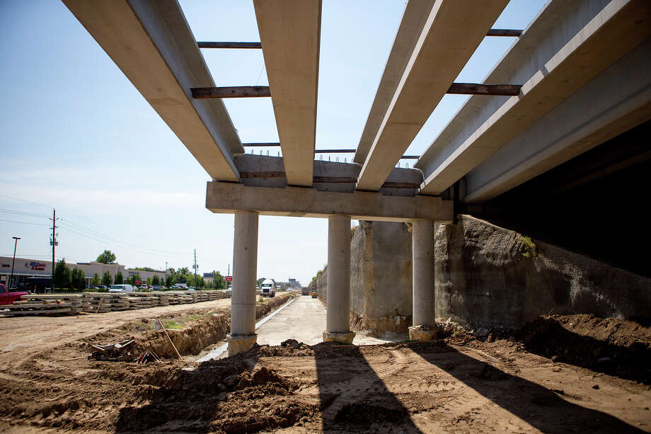 The Berry Education Support Center will host a Sept. 1 meeting by the Texas Department of Transportation about U.S. 290. Above, a crew works along U.S. 290 near Telge Aug. 12. Photo: Cody Duty, Staff / © 2015 Houston Chronicle