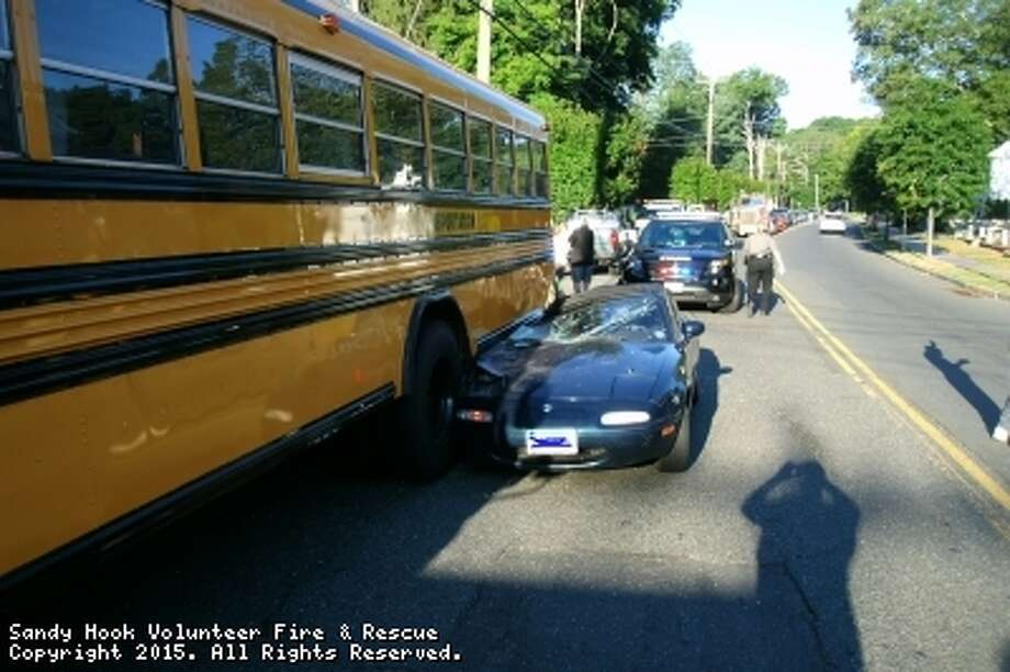 A convertible car struck a parked school bus on Church Hill Road in Newtown Thursday morning. Photo: Contributed / Sandy Hook Volunteer Fire And Rescue Company
