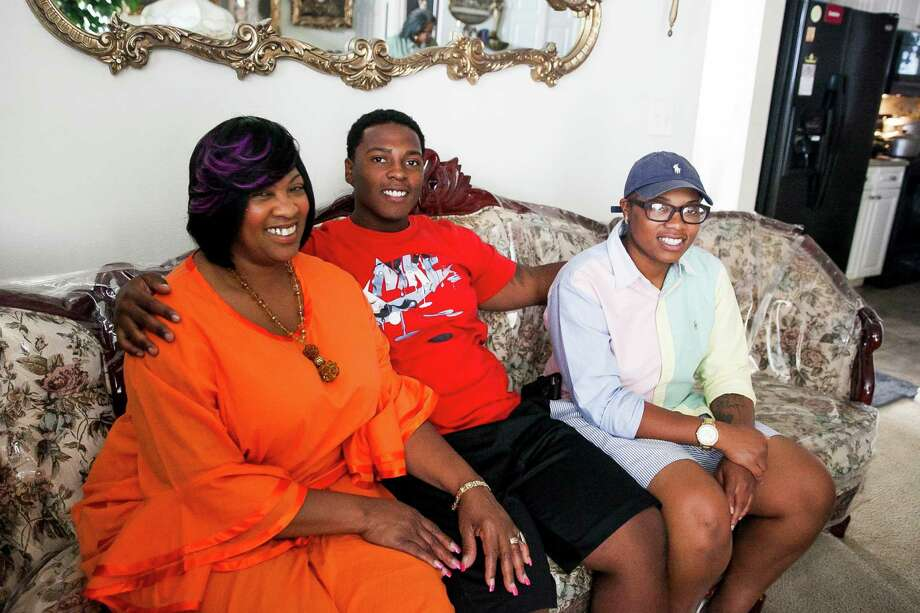 "Debbie Madison, with son Dave and daughter Milika, survived Katrina in New Orleans. ""We fell down and we had faith and strength to get up,"" she said. Photo: Julysa Sosa /For The San Antonio Express-News / Julysa Sosa For the San Antonio Express-News"