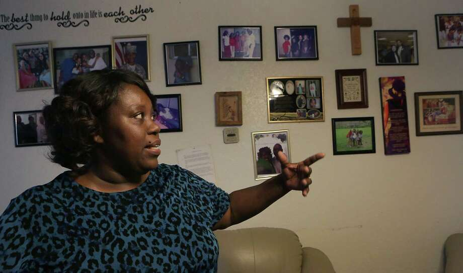 Zabrina Priestley Olanipekun, an evacuee from Hurricane Katrina, talks about family members in her life, in her home in San Antonio on Thursday, August 27, 2015.  A foster mother many times over, she still feels she is called by God to help others. Photo: BOB OWEN / San Antonio Express-News / San Antonio Express-News