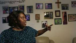Zabrina Priestley Olanipekun, an evacuee from Hurricane Katrina, talks about family members in her life, in her home in San Antonio on Thursday, August 27, 2015.  A foster mother many times over, she still feels she is called by God to help others.