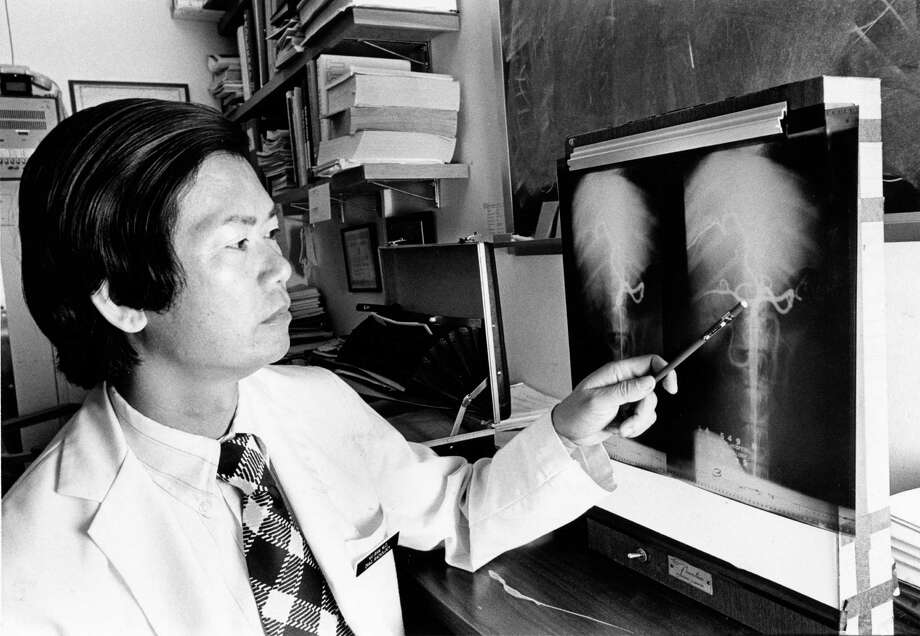 08/1975 - Dr. Vu Ban, a plastic surgeon, is working on a radiology research project at the University of Texas M.D. Anderson Cancer & Tumor Institute. He says Houston's warm weather is similar to Saigon's climate. Dr. Ban and his family are refugees from Vietnam who have relocated to Houston earlier this year and are sponsored by the Houston Lions Club. Photo: Othell O. Owensby Jr., © Houston Chronicle / Houston Chronicle
