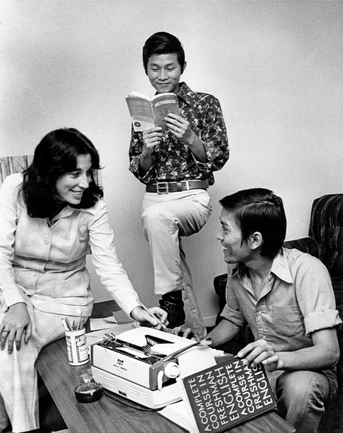 08/21/1975 - (L-R) Wendy Smolins, with the Jewish Family Service, advises Vietnamese refugees Nguyen Van Tu and Nguyen Van Hoa. The local agency is sponsoring 25 Asian refugees in the Houston area; mostly helping them find jobs and learn English.