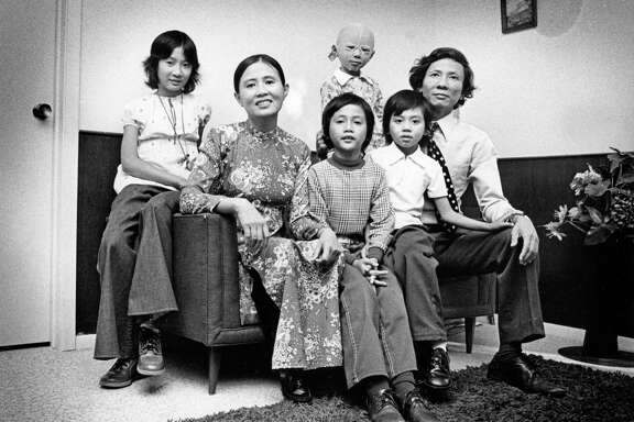 11/1975 - The Mai family is among 121 refugee families on welfare in the Houston area. (L-R) Thi Duy, Nghi Nu Ton, Duy Huyen, Kim Khanh, Kim Anh, Mai Duy Ba. Mai Duy Ba was a successful architect in South Vietnam who designed the first supermarket in Saigon as well as numerous houses, restaurants and warehouses. But even with those qualifications, Mai has not been able to find a job in Houston.