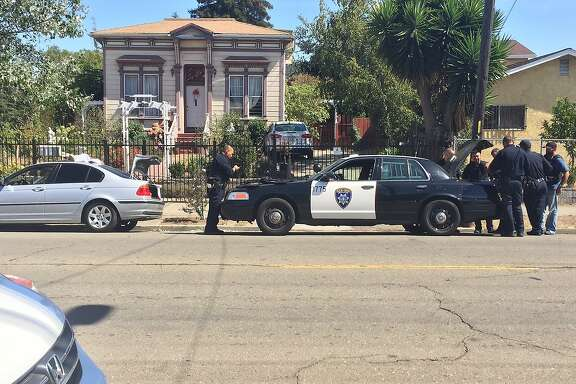 Oakland police and members of a regional task force gathered on the 2300 block of 19th Avenue in Oakland to investigate a lead in the theft of a Hayward police officer's gun.