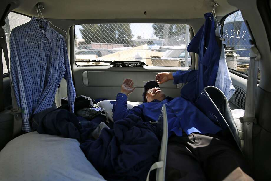 Apple bus driver Scott Peebles naps in his van between shifts in San Jose , Calif., on Thursday, Aug. 27, 2015. Photo: Scott Strazzante, The Chronicle
