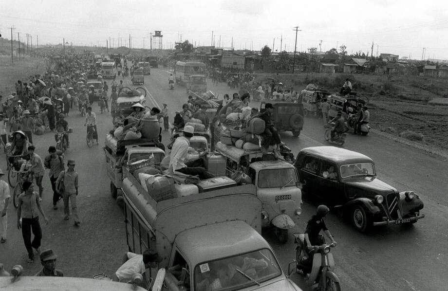 April 28, 1975 - Refugees fleeing advancing communist forces flood into Saigon arriving in jammed vehicles and on foot from rural districts north of the South Vietnamese capital. The communists entered the city two days later. Photo: H. HUNG, AP / AP