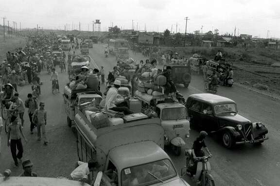 April 28, 1975 - Refugees fleeing advancing communist forces flood into Saigon arriving in jammed vehicles and on foot from rural districts north of the South Vietnamese capital. The communists entered the city two days later.