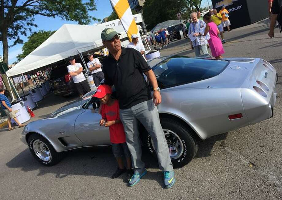 George Talley of Detroit and his 7-year-old grandson enjoy his newly restored 1979 Corvette. The car was stolen in 1981 in Detroit and found 33 years later in Mississippi. General Motors retrieved the car and had it restored for Talley, a retiree and veteran who still lives in Detroit, Aug. 15, 2015.