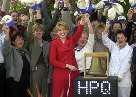 Hewlett-Packard Co. chief executive Carly Fiorina rings a bell to virtually open the New York Stock Exchange from HP's headquarters in Palo Alto, Calif., Monday, May 6, 2002. HP changed its ticker symbol from HWP to HPQ to reflect its recent $19 billion acquisition of Compaq Computer Corp. Investors in Compaq, which will no longer exist as a separate company, will receive 0.6325 of a Hewlett-Packard share for each Compaq share they own.