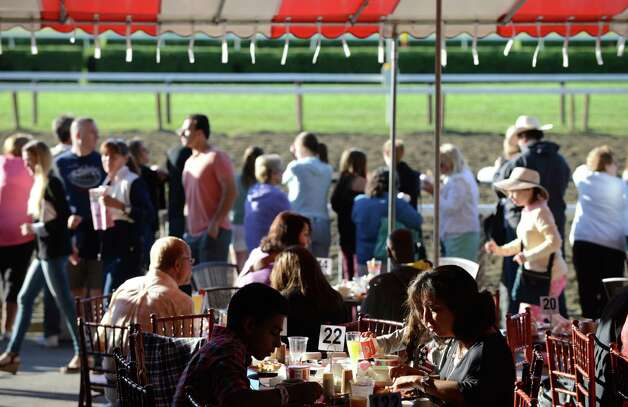 Breakfast tables were filled with spectators at Saratoga Race Course for Triple Crown winner American Pharoah's morning work out Friday, Aug. 28, 2015, in Saratoga Springs, N.Y. Pharoah will compete in Saturday's Travers Stakes. (Will Waldron/Times Union) Photo: WW / 00033155B