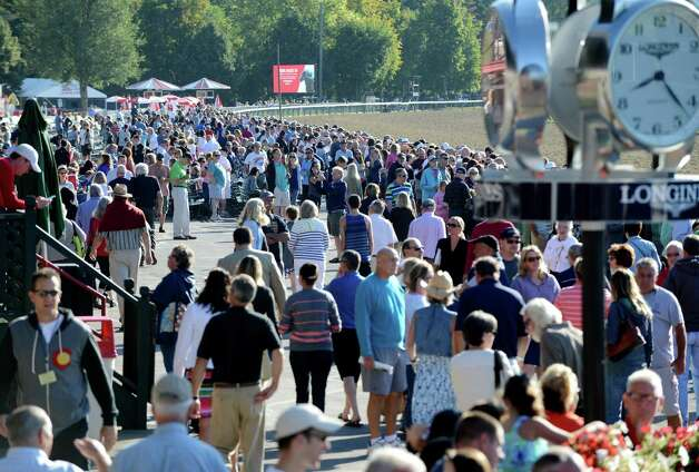Spectators filled the track at Saratoga Race Course to view Triple Crown winner American Pharoah's morning work out Friday, Aug. 28, 2015, in Saratoga Springs, N.Y. Pharoah will compete in Saturday's Travers Stakes. (Will Waldron/Times Union) Photo: WW / 00033155B