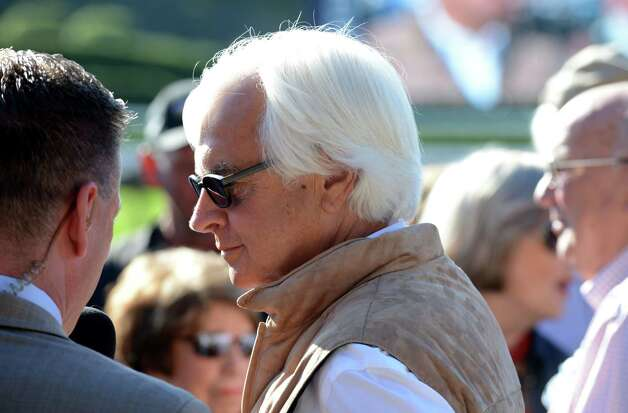 Trainer Bob Baffert speaks to the press in the winner's circle at Saratoga Race Course following Triple Crown winner American Pharoah's morning workout Friday, Aug. 28, 2015, at Saratoga Race Course in Saratoga Springs, N.Y. American Pharoah will compete in Saturday's Travers Stakes. (Will Waldron/Times Union) Photo: WW / 00033155B