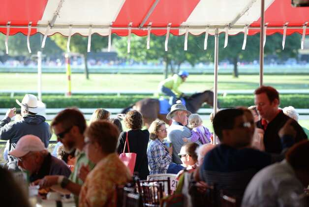 Breakfast tables were filled with spectators at Saratoga Race Course for Triple Crown winner American Pharoah's morning workout Friday, Aug. 28, 2015, in Saratoga Springs, N.Y. Pharoah will compete in Saturday's Travers Stakes. (Will Waldron/Times Union) Photo: WW / 00033155B