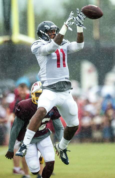 Texans wide receiver Jaelon Strong leaps for a pass.   Brian Hoyer throws pass during Texans training camp at the Methodist Training Center Tuesday, Aug. 18, 2015, in Houston.  ( Brett Coomer / Houston Chronicle ) Photo: Brett Coomer, Staff / © 2015 Houston Chronicle