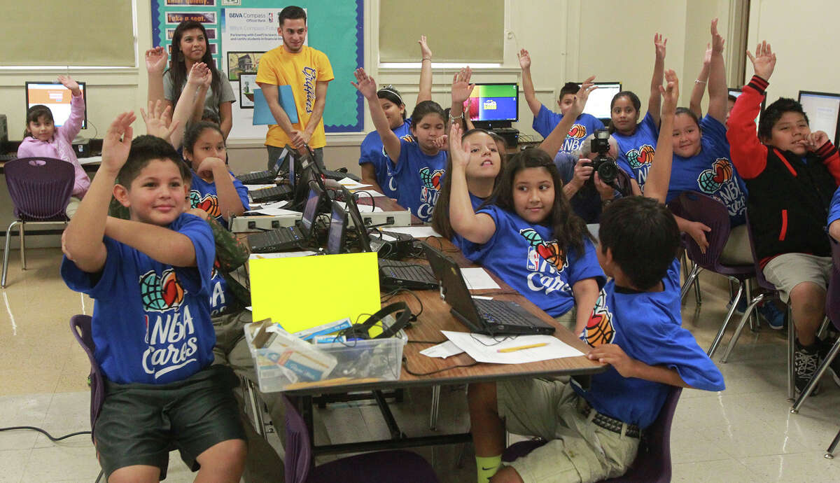 The Texas Supreme Court will hear arguments in yet another legal challenge to how the state finances its public schools. At the moment, low-income school districts suffer. These children at Graebner Elementary school raise their hands while former San Antonio Spur Bruce Bowen asks a question in Octtober 2014.