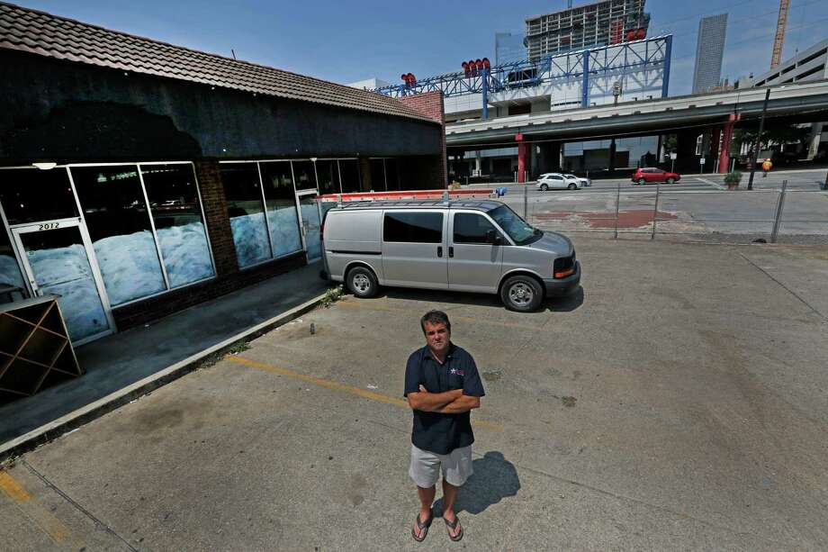 Wesley Jurena poses for a portrait Wednesday, Aug. 26, 2015, in Houston. He is opening his first brick-and-mortar Pappa Charlie's Barbeque, 2012 Rusk, just east of downtown. He's leasing space in a strip center that could be acquired and demolished by TxDOT for a massive highway rebuilding project, a portion of which calls for removing the Pierce Elevated and realigning I-45 to be parallel to Interstate 10 and U.S. 59 near downtown  ( Steve Gonzales / Houston Chronicle ) Photo: Steve Gonzales, Staff / © 2015 Houston Chronicle