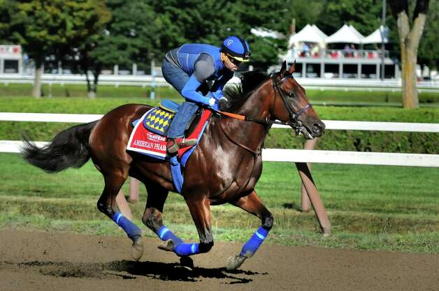 Triple Crown winner American Pharoah gallops around the track during a morning workout on Friday, Aug. 28, 2015, at Saratoga Race Course in Saratoga Springs, N.Y. American Pharoah will compete in Saturday's Travers Stakes. (Cindy Schultz / Times Union) Photo: Cindy Schultz
