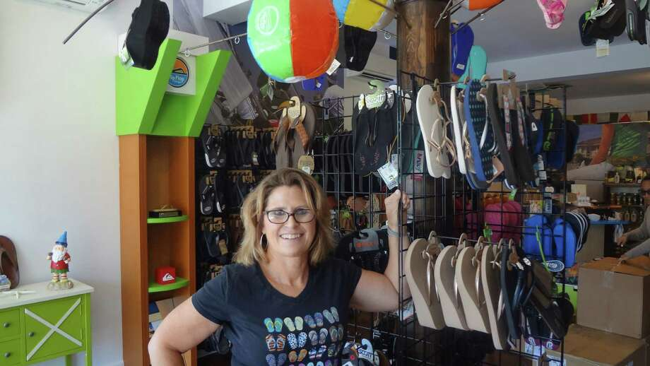 After opening a Flip Flop Shops franchise store in Fairfield, Karen Breault has moved the shop to 705 Shippan Avenue in Stamford, down the street from where she grew up. Photo: Alexander Soule / Hearst Connecticut Media / Stamford Advocate