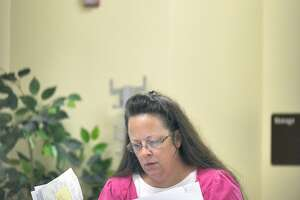 High court rules against Kentucky clerk in same-sex marriage case - Photo